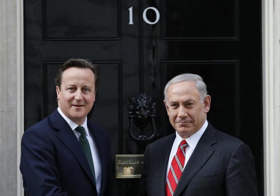 British Prime Minister David Cameron (L) greets Prime Minister Benjamin Netanyahu at 10 Downing St.