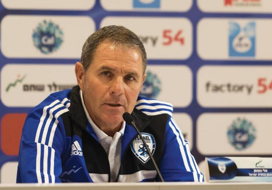 Israeli national soccer team coach Eli Gutman speaks to reporters
