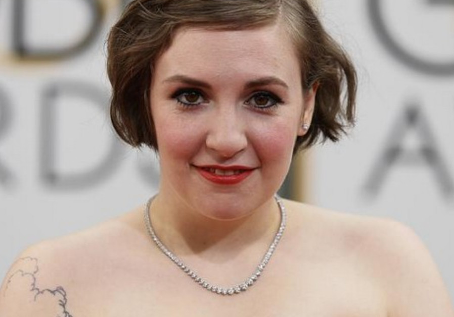Actress Lena Dunham arrives at the 71st annual Golden Globe Awards in Beverly Hills, California