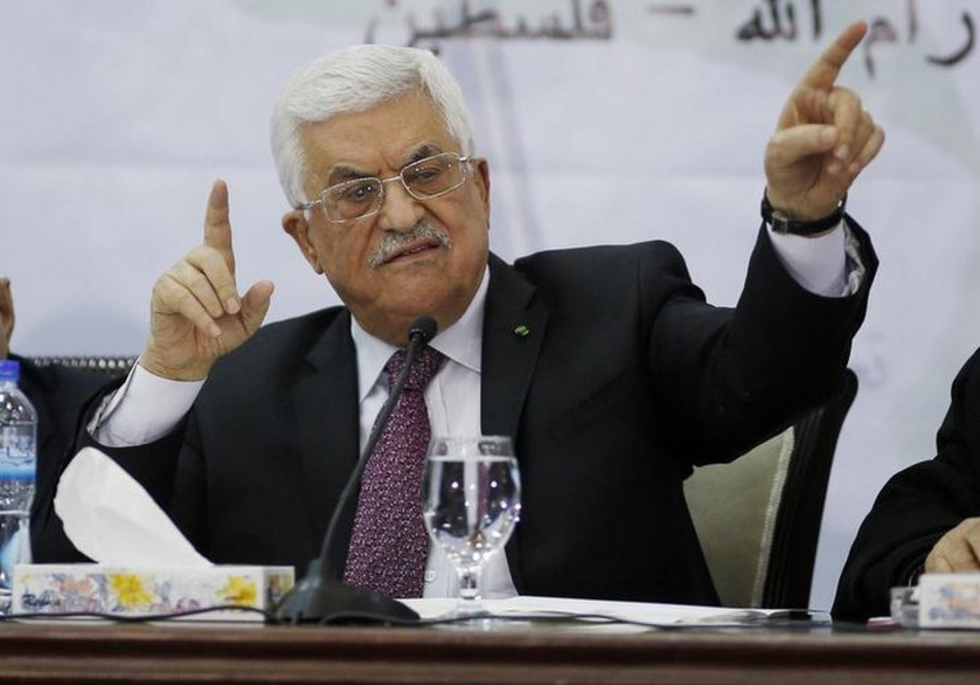 Palestinian Authority Chairman Mahmoud Abbas gestures as he speaks during a meeting in Ramallah