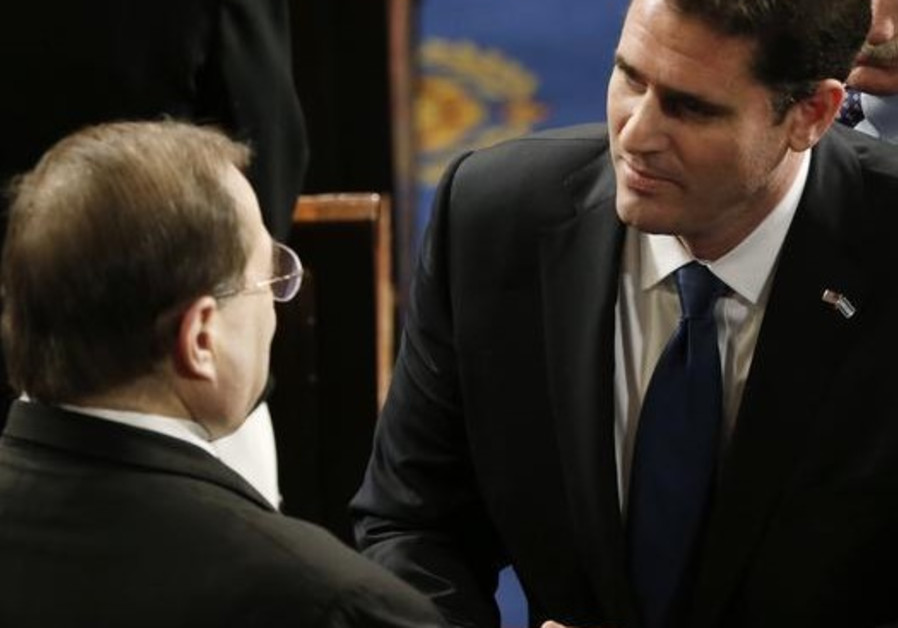 Israel's ambassador to the US, Ron Dermer (R) greets House Rep. (D) Jerrold Nadler