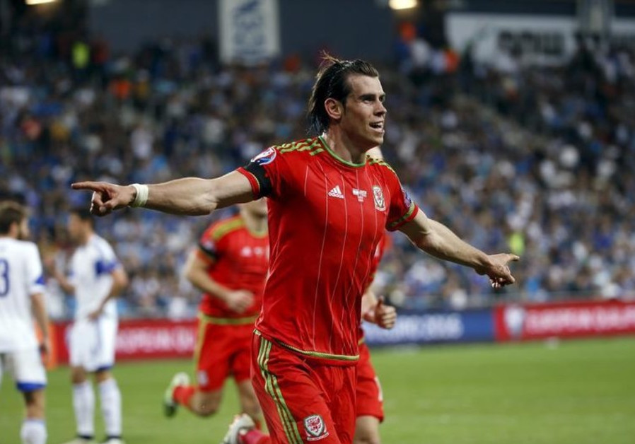 Wales' Gareth Bale celebrates scoring a goal against Israel during their qualifying match
