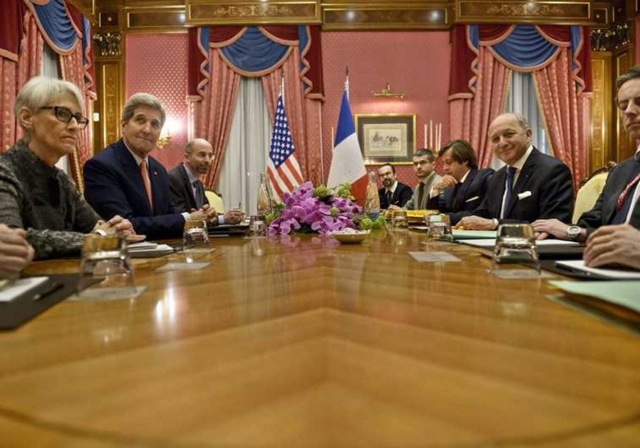 Kerry (2nd L) and French FM Fabius (2nd R) wait for a meeting in Lausanne  March 28, 2015.