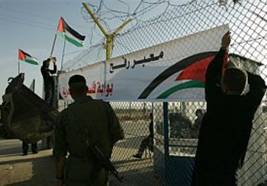 workers hang up sign in rafah 298 88 ap