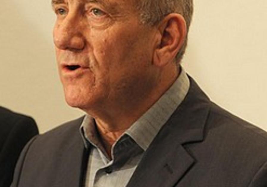 Olmert inaugurates Holocaust survivors' help line