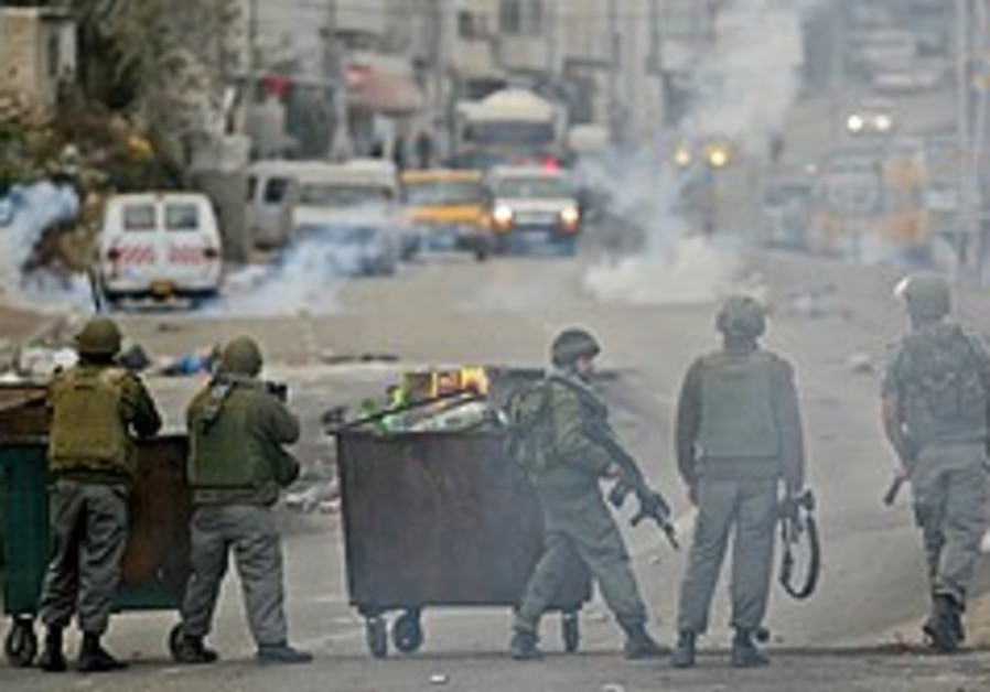 2 Palestinians wounded in police chase