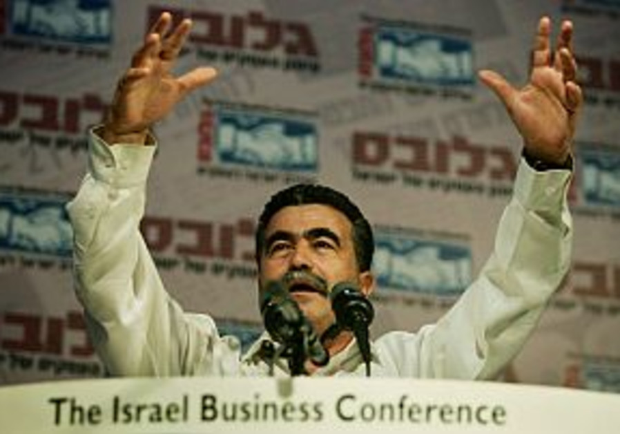peretz speaks with arms raised 298