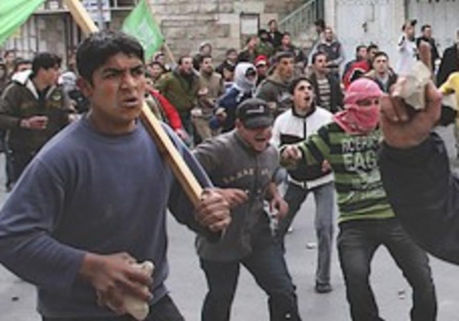 'IDF kills Palestinian W. Bank rioter'