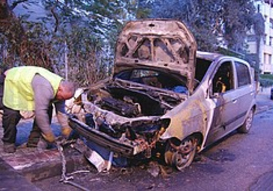 Sneh's car torched next to his Herzliya home
