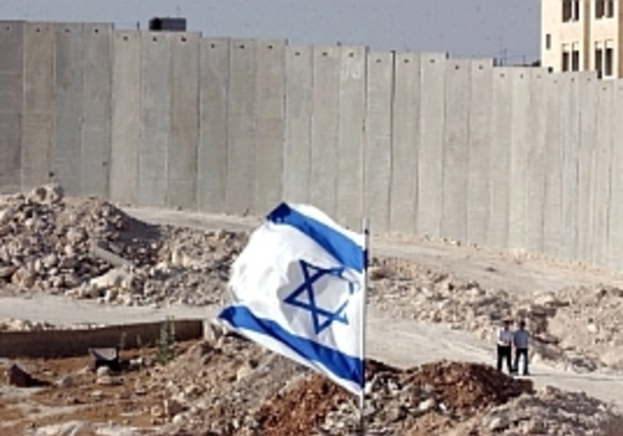 Olmert orders gaps in Jerusalem fence closed