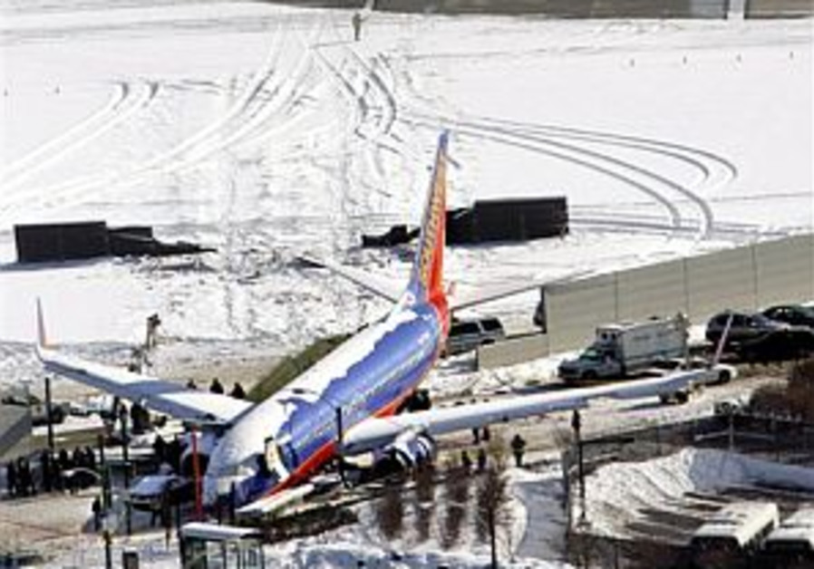 Jetliner slides off runway and through fence in Chicago
