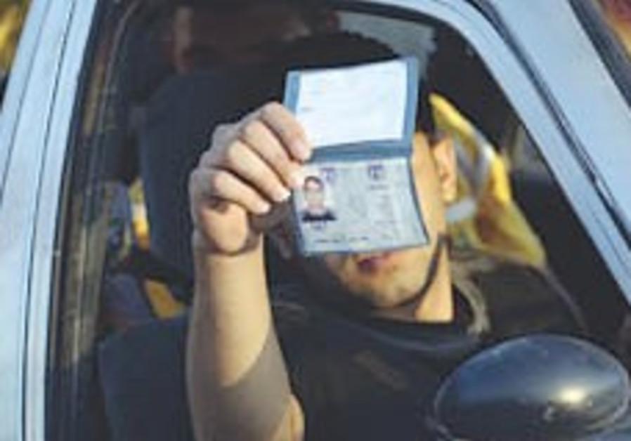 E. J'lem teens seek Israeli IDs despite Gaza op anger