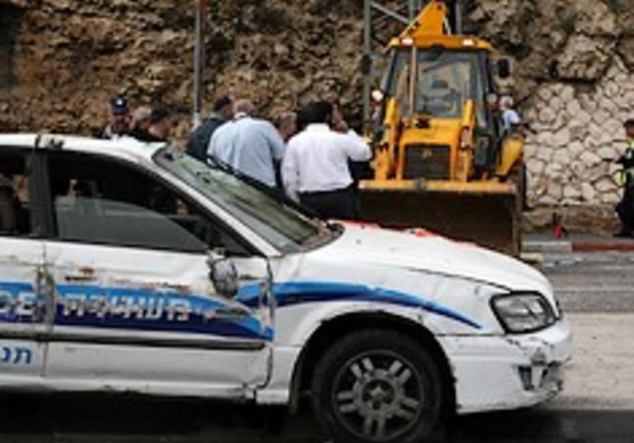 Bulldozer runs car off W. Bank road