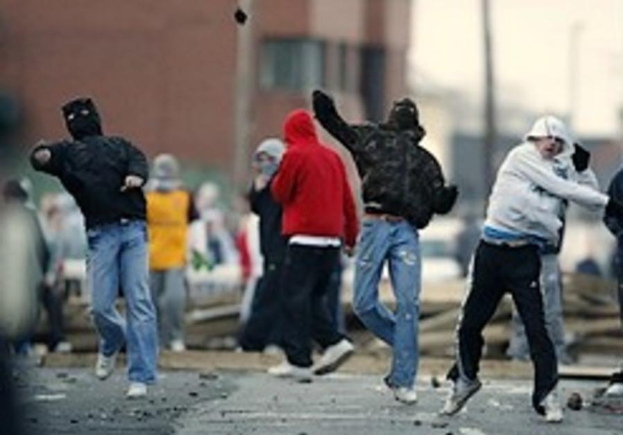 Northern Ireland riots erupt after police arrest 3 over killings