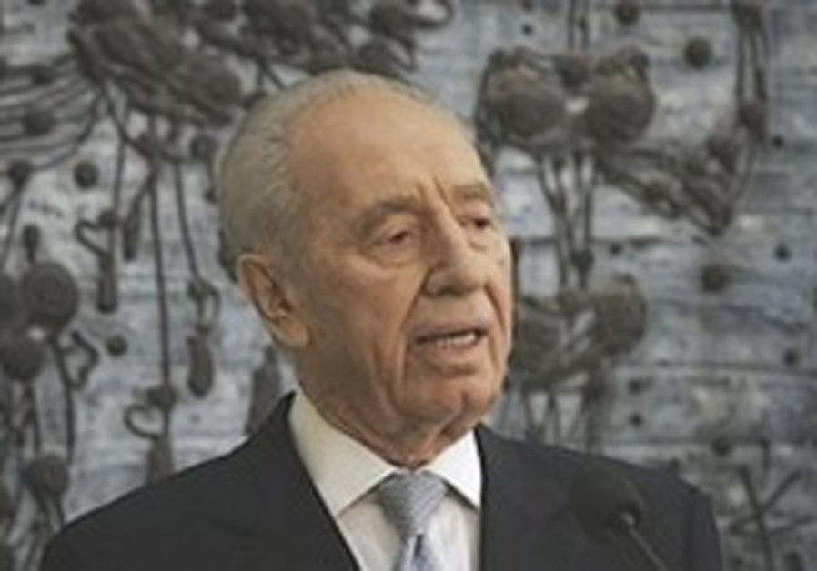 Peres makes rare hint at possible strike on Iran
