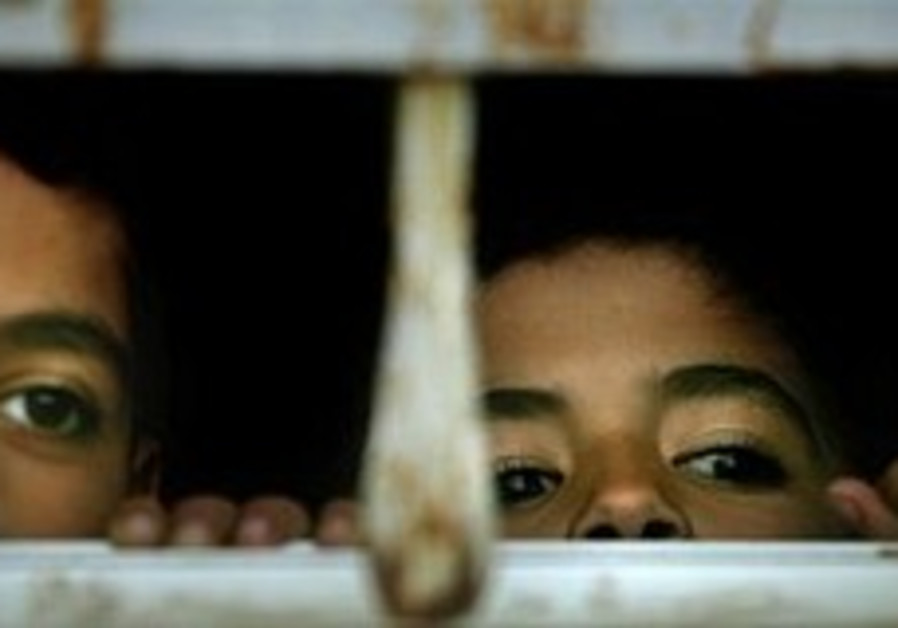 palestinian kids looking through window 298.88