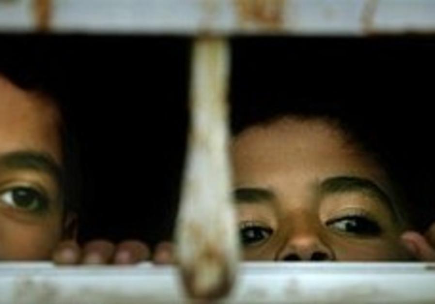 palestinian kids looking through window 298.88