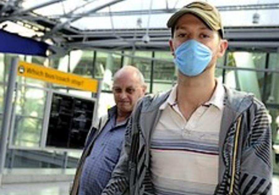 Swine flu fear catches fast in weak world economy