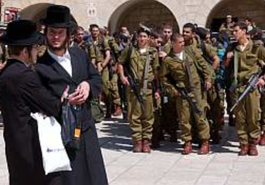 haredim near soldiers at the kotel 298