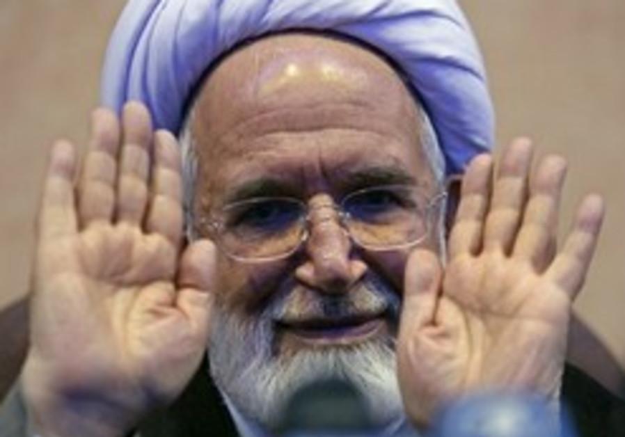 Iran: Polls put Ahmadinejad in lead for June 12