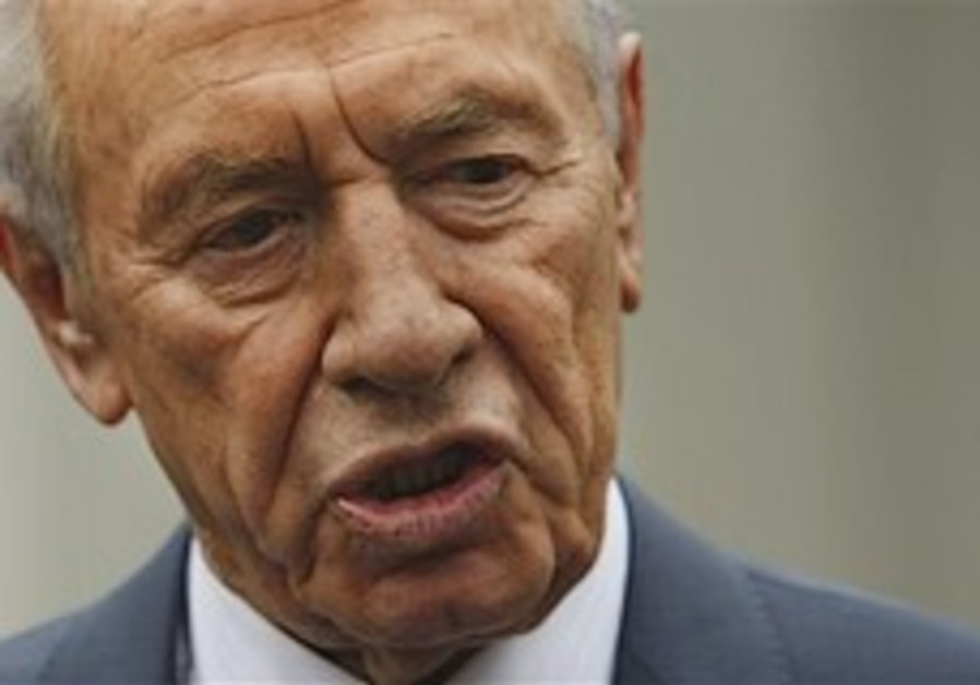 Peres: We won't apologize for Gaza op