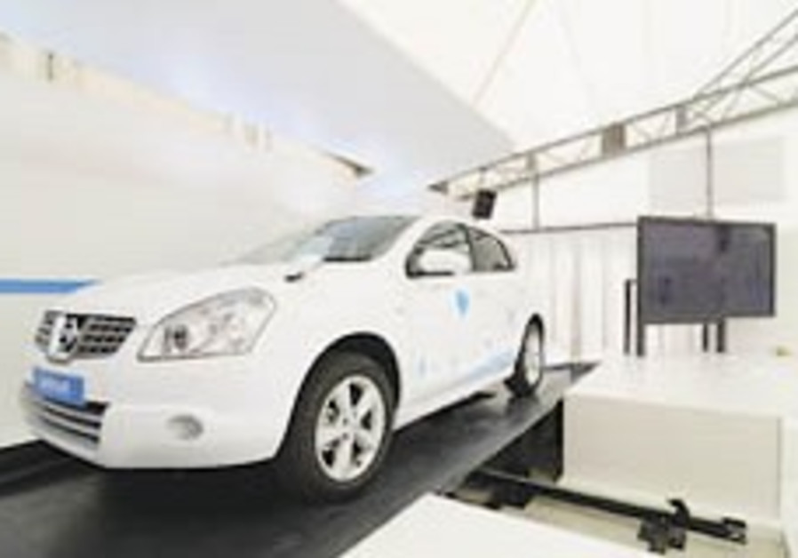 Better Place presents world's first automated battery switch station in Japan
