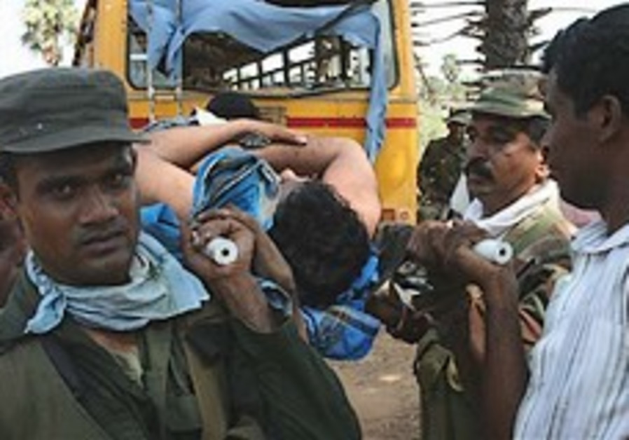 Sri Lanka says civilians out of war zone, declares victory