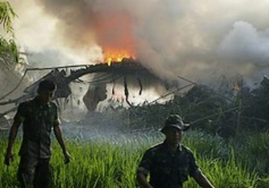 Indonesian plane crashes, at least 98 dead