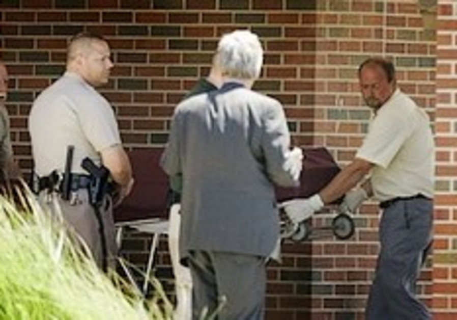 Kansas abortion doc killed in church; suspect held