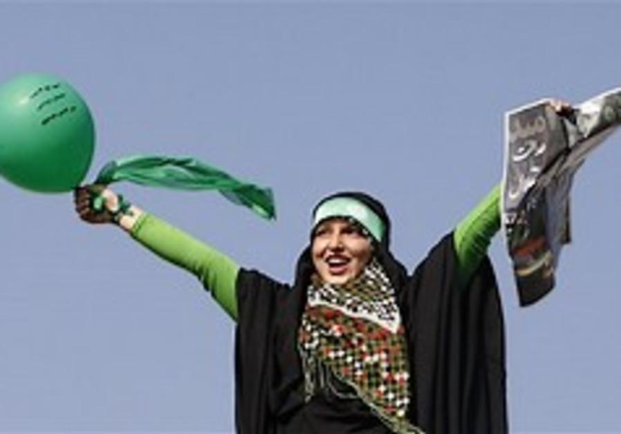 Analysis: Ahmadinejad's power vs 'green' reformist in Iran