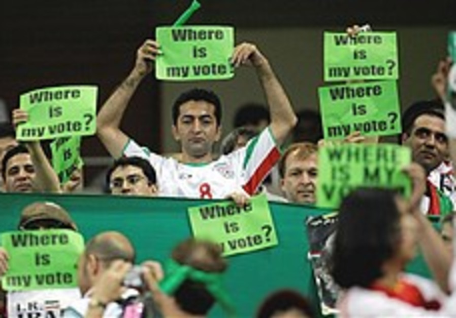 Iranian soccer team wears green bands