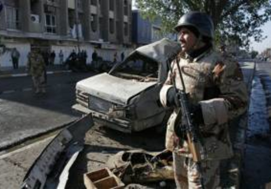 soldier in front of iraq car bomb 12-26-05