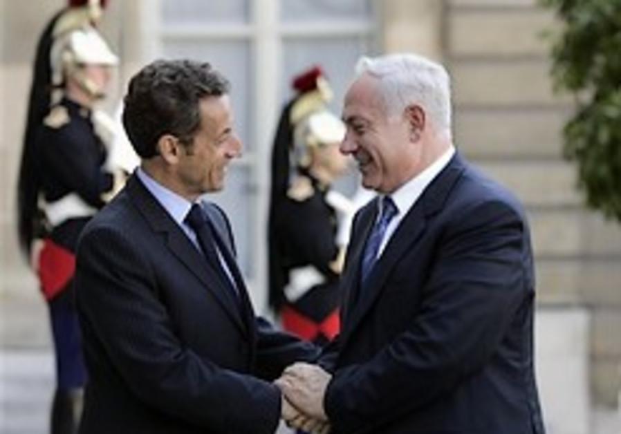 'France: Int'l oversight on settlement freeze'