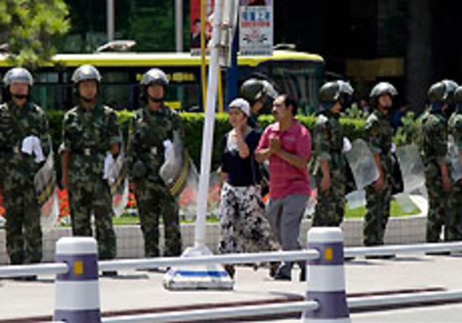 China says 156 killed in riots in west