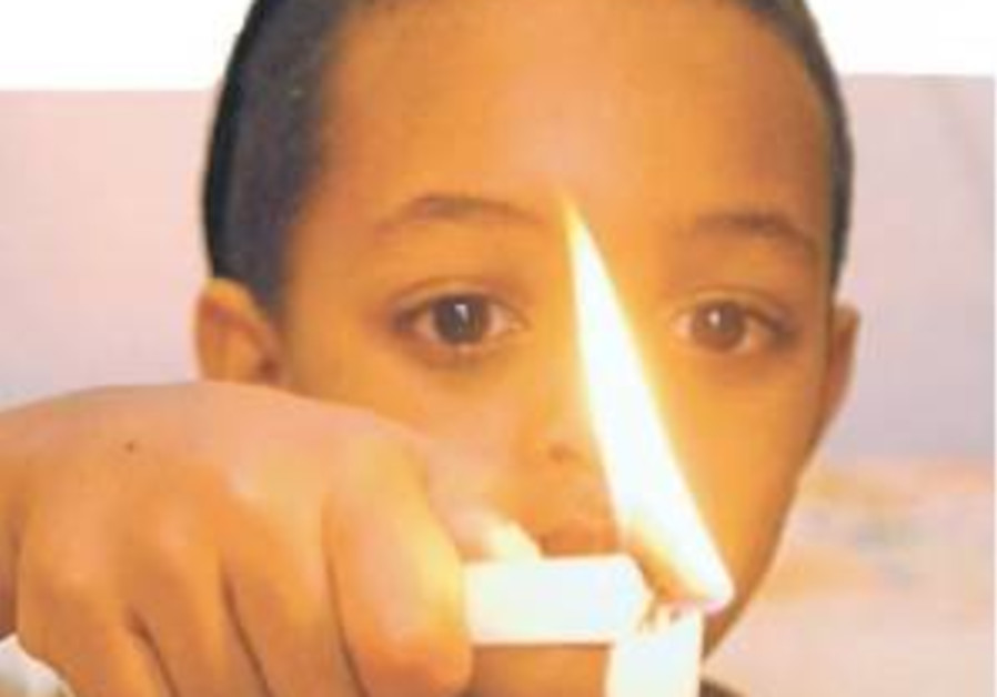 cute ethiopian kid lights candle
