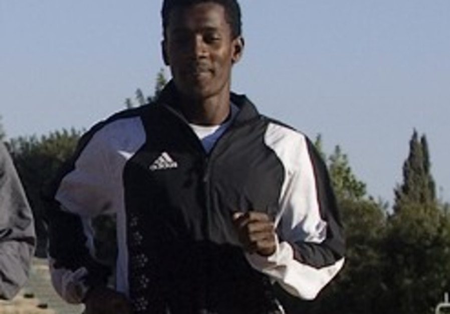 Ethiopian athlete represents Israel worldwide - but half his family can't enter the country