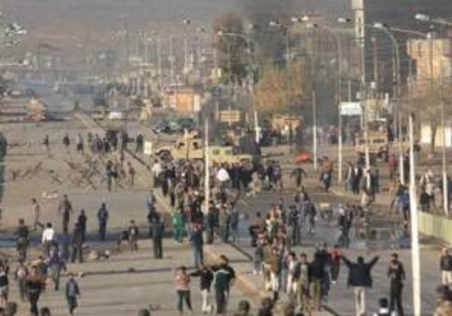13 car bombs explode in Iraq as Sunnis enter political arena
