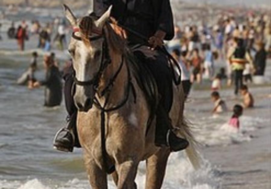 Hamas to female lawyers: Wear headscarf