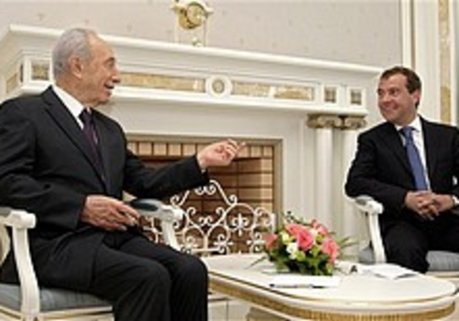Peres: Iran nuke would be 'flying death camp'
