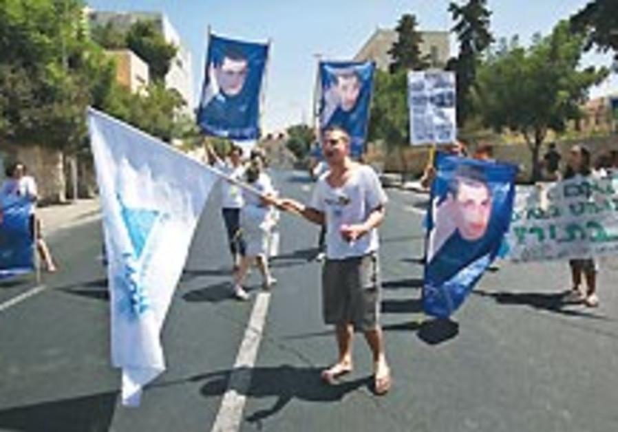 Noam Schalit: Gilad's a hostage, not POW