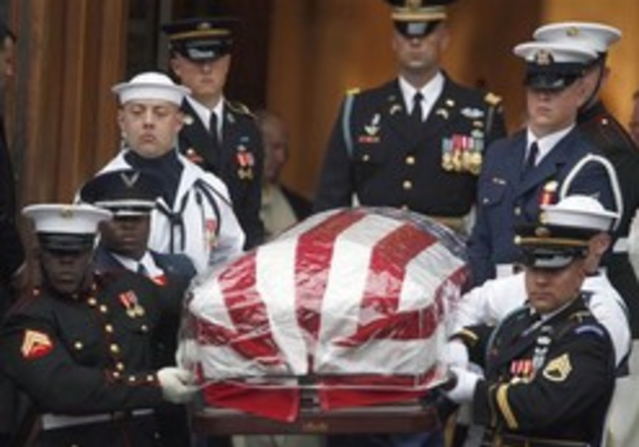 Senator Kennedy is laid to rest beside brothers