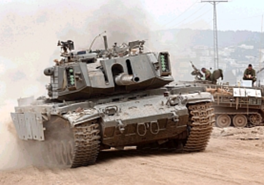 tank kicks up dust in jenin 298