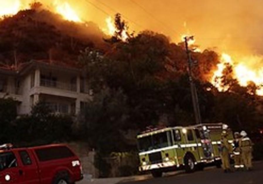 As California fires spread, residents return