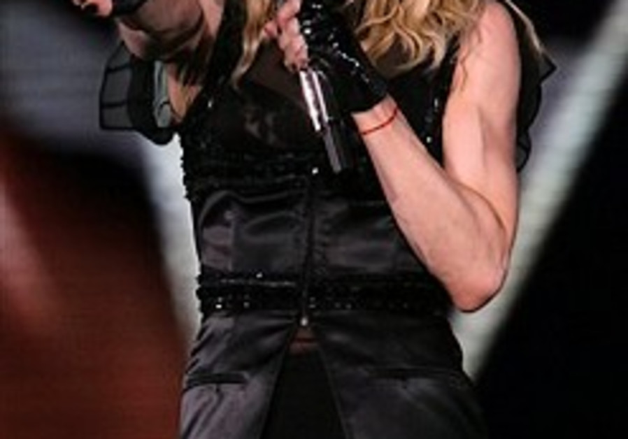 Madonna performs for 50,000 in 1st of 2 TA gigs