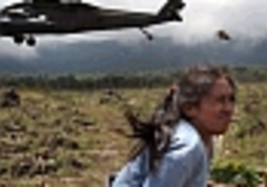 girl ducks from helicopter wind in guatemala 88