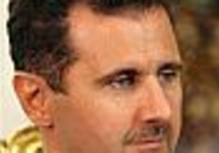 assad sits in chair 88