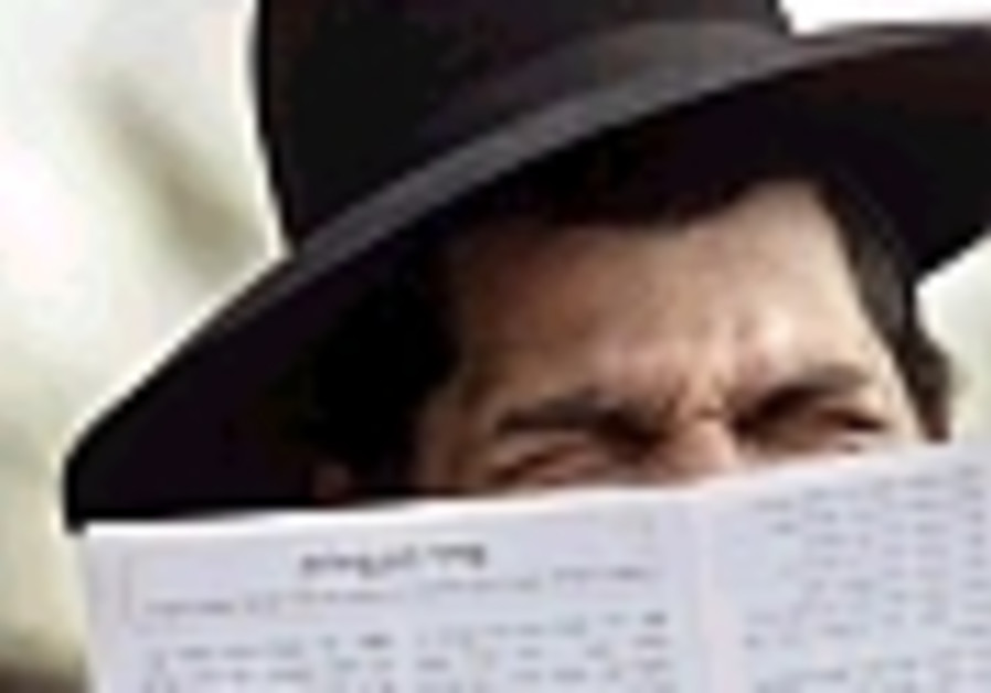 haredi man behind book 88