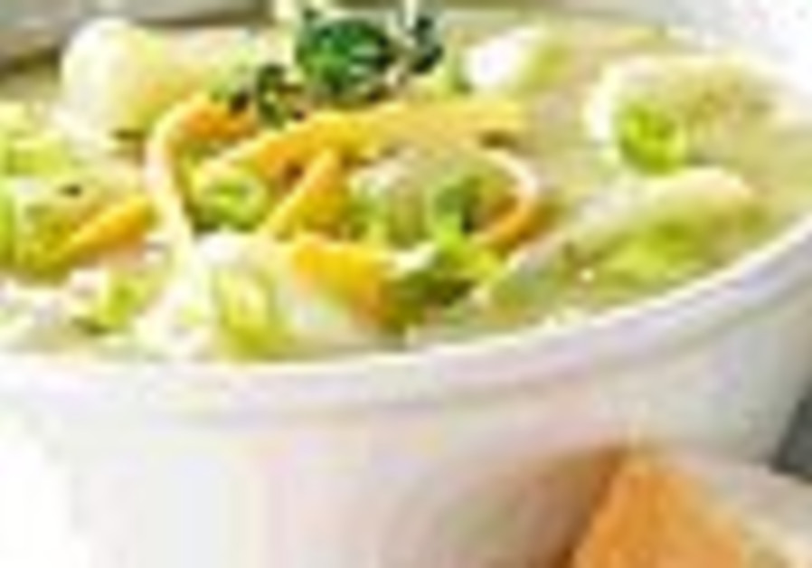 soup in white bowl next to bread 88