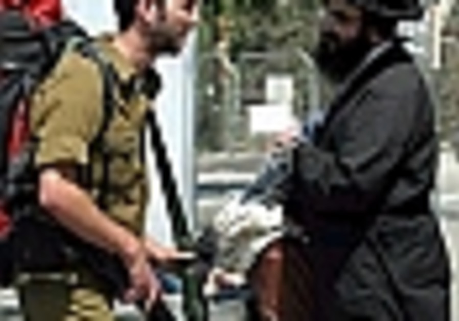 soldier talking to haredi outdoors 88 ap