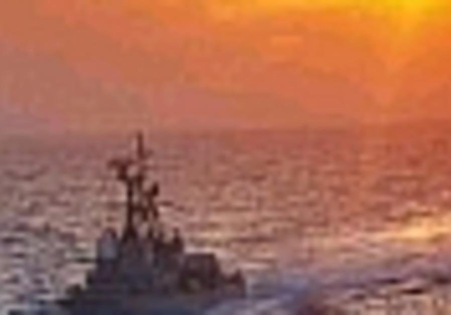 navy ship in sunset